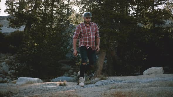 Young Happy Handsome Man Hiking Alone, Walking Towards Camera Out of Focus at Amazing Yosemite