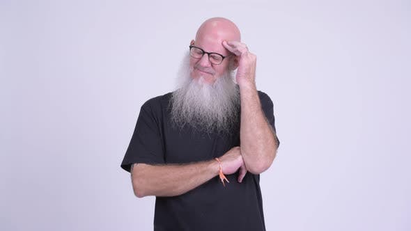 Thumbnail for Stressed Mature Bald Bearded Man Having Headache