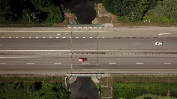 Thumbnail for Top Down Close Up of Highway, White Arrow Signs Indicating Direction