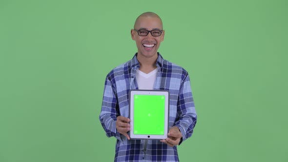 Thumbnail for Happy Bald Hipster Man Showing Digital Tablet and Looking Surprised