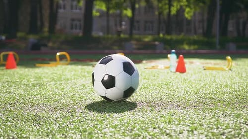 Ball Being on the Artificial Turf of Stadium while Leg Doing Kicks or Pass