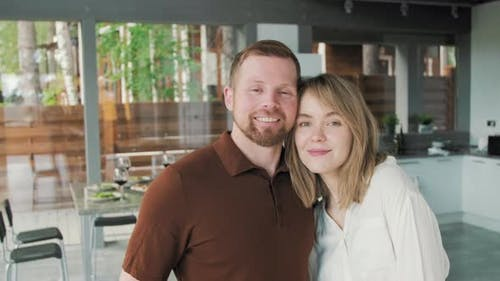 Affectionate Couple Posing in their Modern House