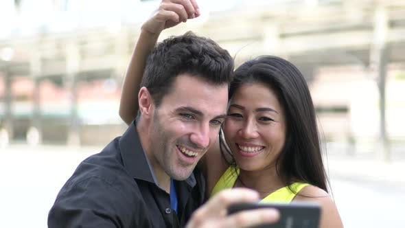 Thumbnail for Young Couple Taking Selfie