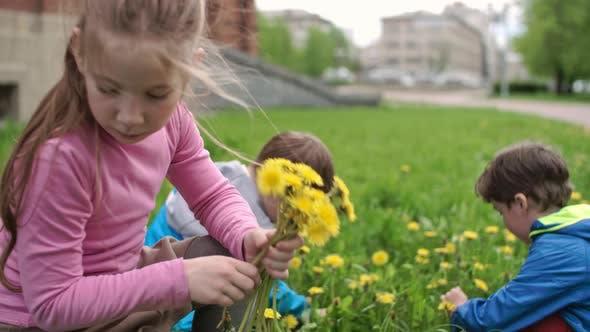 Thumbnail for Preschool Children Collecting Dandelions
