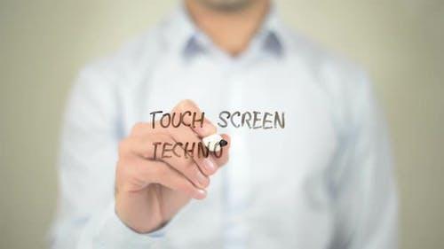 Touch Screen Technology, Businessman Writing on Transparent Screen