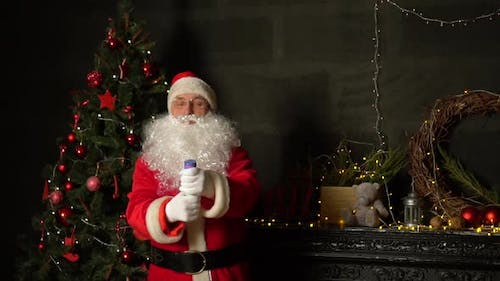 Santa blowing up a petard against the tree. Slow motion.