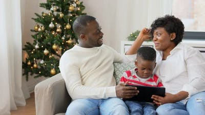 African Family with Tablet Pc on Christmas