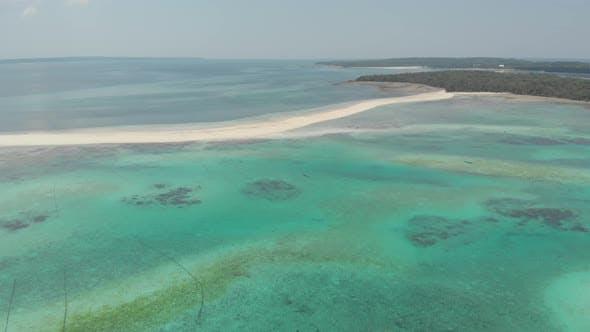 Thumbnail for Aerial: tropical beach island reef caribbean sea white sand beach Indonesia Moluccas archipelago