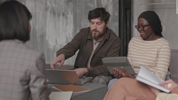 Coworkers Talking on Meeting