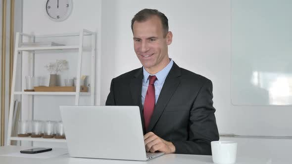 Thumbnail for Video Chat in Office By Middle Aged Businessman