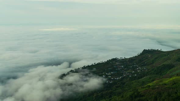 Thumbnail for Fog Moving Above Village In Mountain
