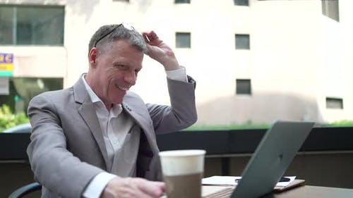businessman drinking coffee and working business with online community by laptop