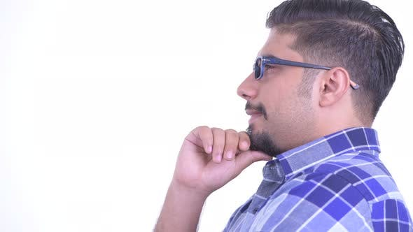 Thumbnail for Closeup Profile View of Happy Bearded Persian Hipster Man Thinking