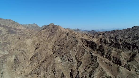 Thumbnail for Aerial view of rock mountains in the United Arab Emirates.