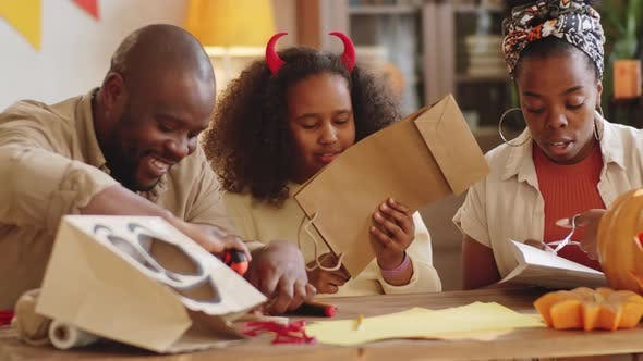 Thumbnail for Cheerful Black Family Doing Halloween Crafts Together at Home