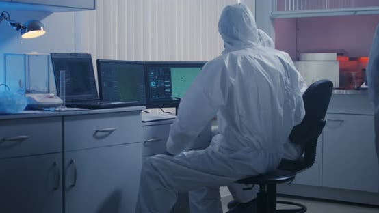 Thumbnail for Scientists Watching Monitor in Laboratory
