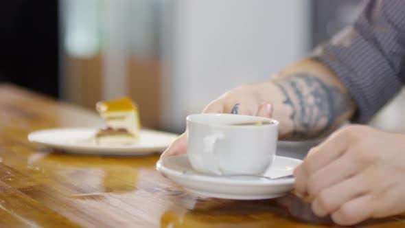 Thumbnail for Tattooed Barista Bringing Americano to Woman Eating Cake