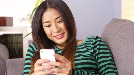 Thumbnail for Japanese woman texting on smartphone