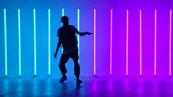 Silhouette of a Stylish Young Man Dancing and Performing Contemporary Choreography
