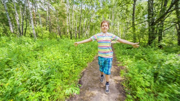 Cover Image for Teenage Boy Jogging in Wood