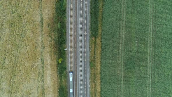 Bird's Eye View of a Commuter Train in the Countryside