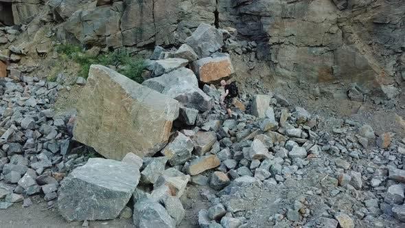 Thumbnail for Man Walking Along Giant Rocky Mountain Wall