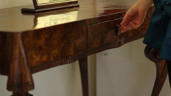 Thumbnail for Girl Opens Stylish Table Drawer