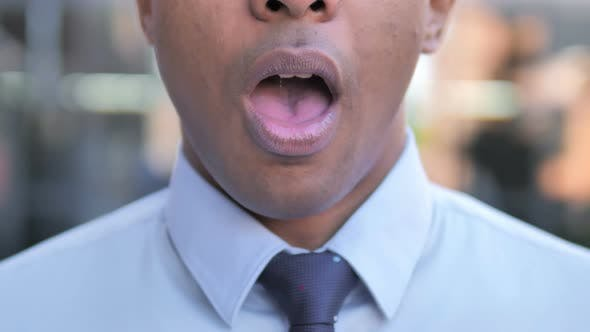 Face of Shocked African Businessman