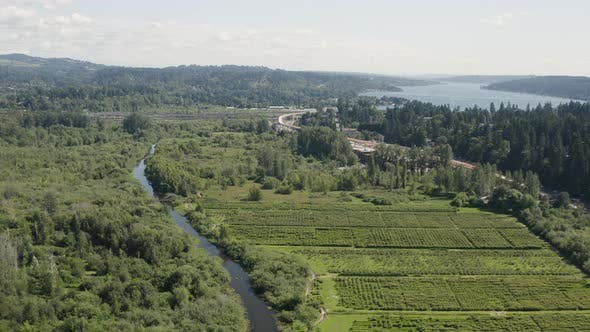 Thumbnail for Mercer Slough Farm Land In Bellevue Wa Aerial Flyover View Of Highway And Lake Washington