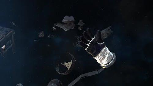 Astronautenhandschuh und Trümmer, die im Weltraum schweben