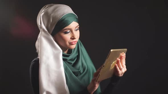 Thumbnail for Portrait of Beautiful Arabic Muslim Girl Using Tablet.