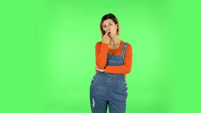 Woman with TV Remote in Her Hand, Switching on TV. Green Screen