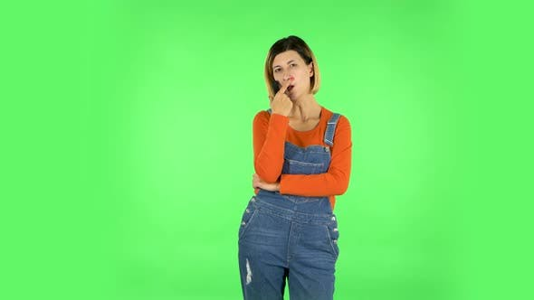 Thumbnail for Woman with TV Remote in Her Hand, Switching on TV. Green Screen