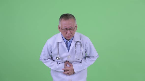Thumbnail for Stressed Mature Japanese Man Doctor Having Stomachache