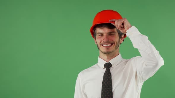 Thumbnail for Cheerful Handsome Male Engineer Wearing Hardhat Winking To the Camera
