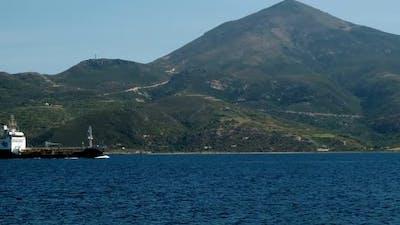 Cargo Ship Pass Harbor of Milos Island Greece