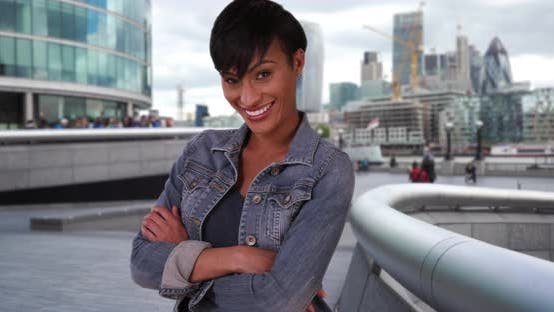 Thumbnail for Short-haired young black woman poses confidently outside in London