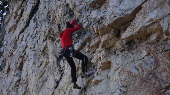 Thumbnail for A young man rock climbing.