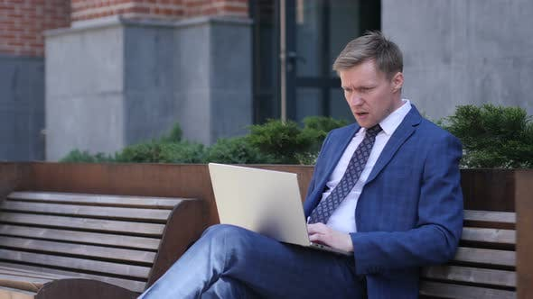 Thumbnail for Shocked, Stunned Businessman Working on Laptop