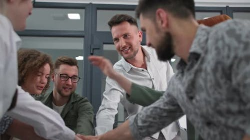 Team Spirit Young Successful Leader Conducts Training for Work Team and Folds Hands in Circle