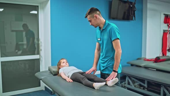 Thumbnail for Young Girl Doing Exercises Under Physiotherapist Supervision