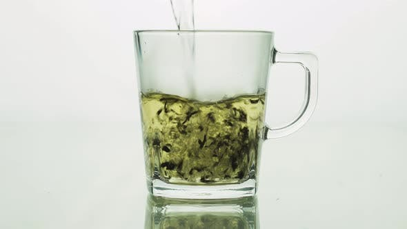 Thumbnail for Black Tea Particles Pouring Into Glass Transparent Mug and Filled with Boiling Water To Brew Tea