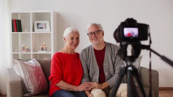 Thumbnail for Happy Senior Couple with Camera Recording Video