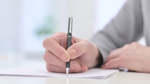 Thumbnail for Close Up of Woman Hands Writing Documents
