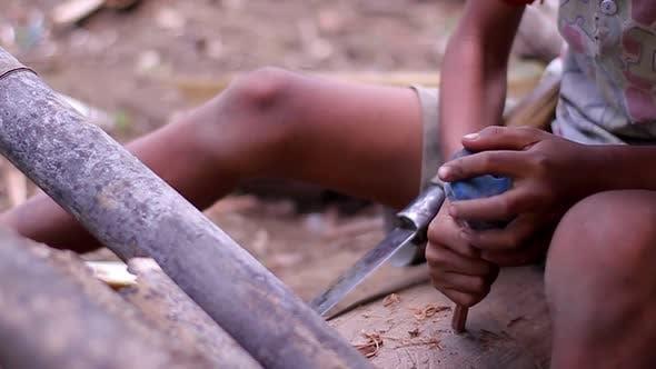 Rural Boy Making Toy.