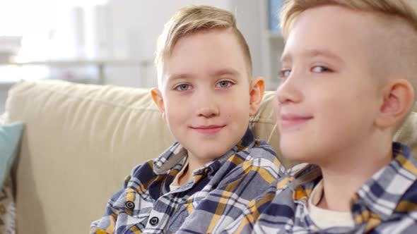 Thumbnail for 10-Year-Old Caucasian Twins Looking Sideways at Camera