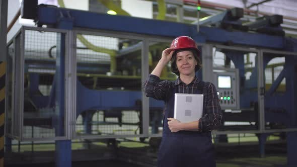 Cover Image for Smiling Female Cutting Machine Operator Posing at Industrial Plant