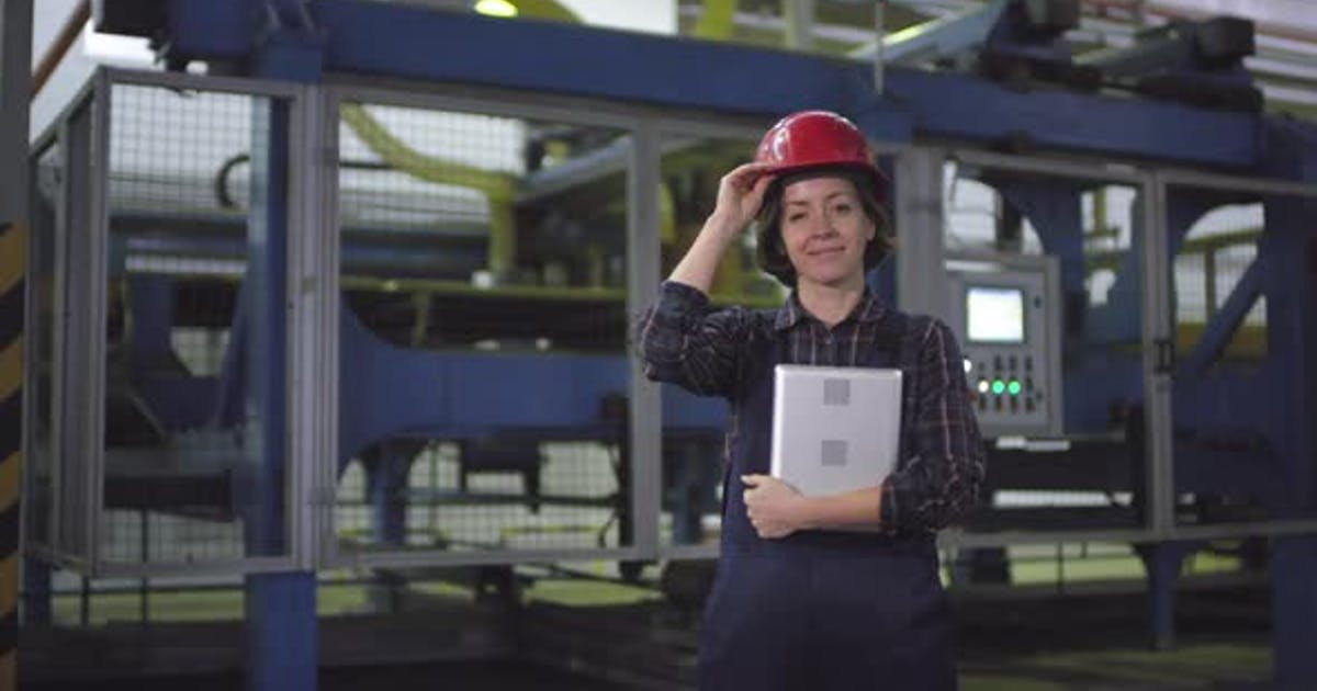 Smiling Female Cutting Machine Operator Posing at Industrial Plant