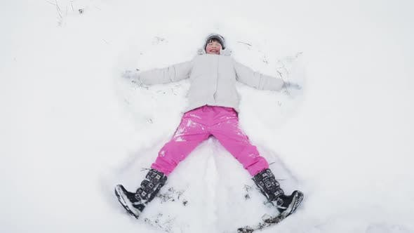 Thumbnail for Happy Cute Little Girl Making Snow Angel
