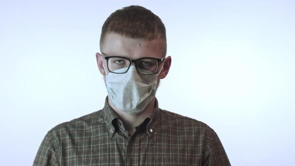 Thumbnail for Man Tears Up Medical Mask Against Covid-19. Fight Against Virus. Stop Quarantine